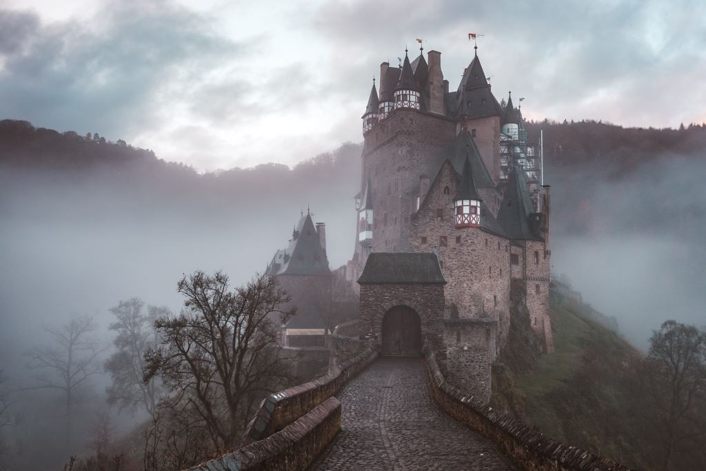 A castle in a misty valley